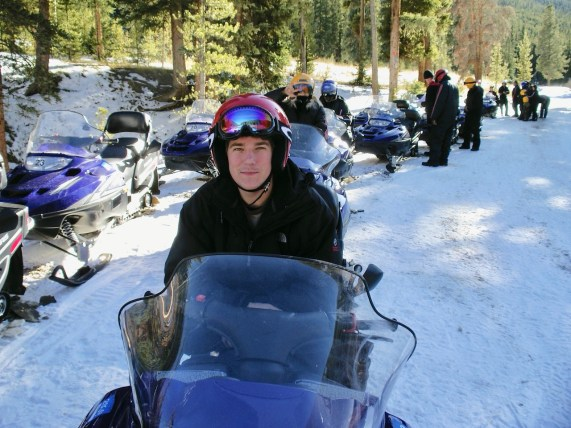Matt on snowmobile in colorado