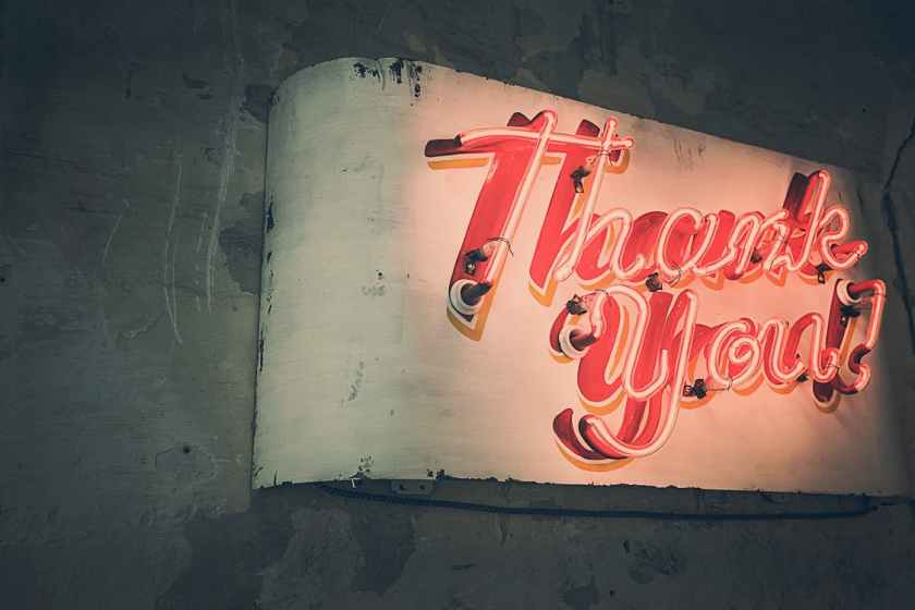 1950s neon sign that says thank you