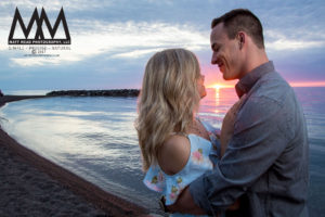 erie pa engagement couple holding each other on beach photo