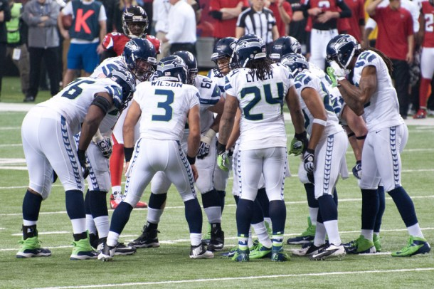 Okung always has his QB's left . . . even in the huddle. Waldman likes that. Photo by Football Schedule.