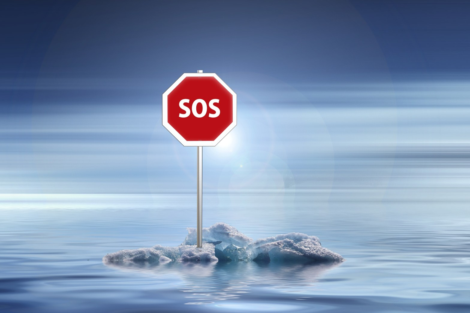 SOS sign on some ice in the middle of the ocean