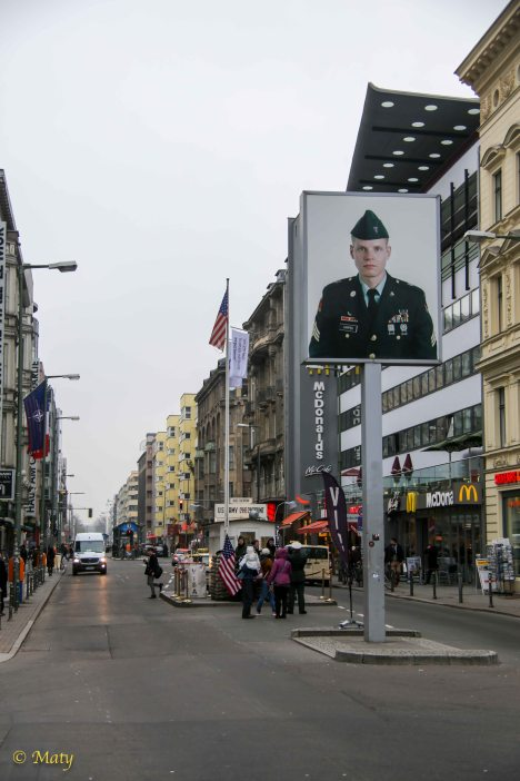 A nice peaceful view of Checkpoint Charlie with young GI...