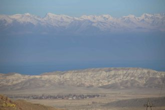 Some serious mountain range, Lake Issyk Kul and village Kara Koo. The true Silk Road passage!