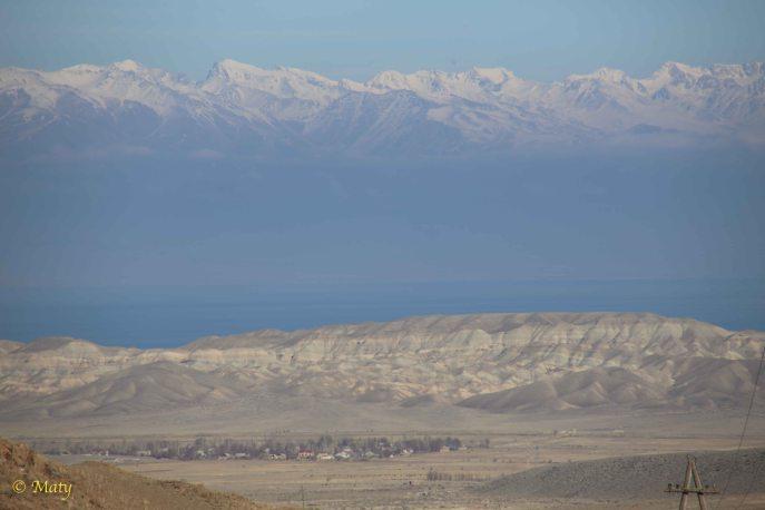 Some serious mountain range, Lake Issyk Kul and village Kara Koo. The true Silk Road passage!