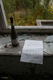some old paperwork and bottle of wine (quite recent)