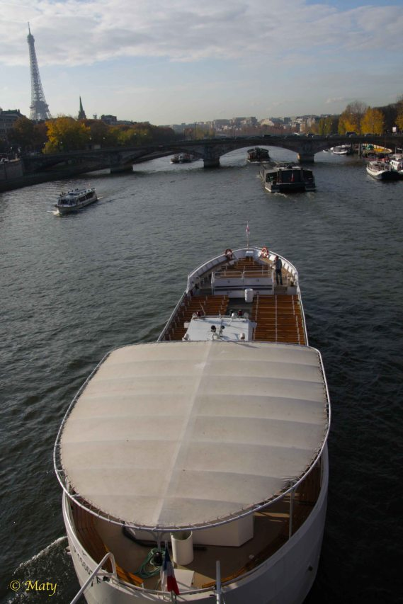 ships at Seine River with Eiffel Tower in the background