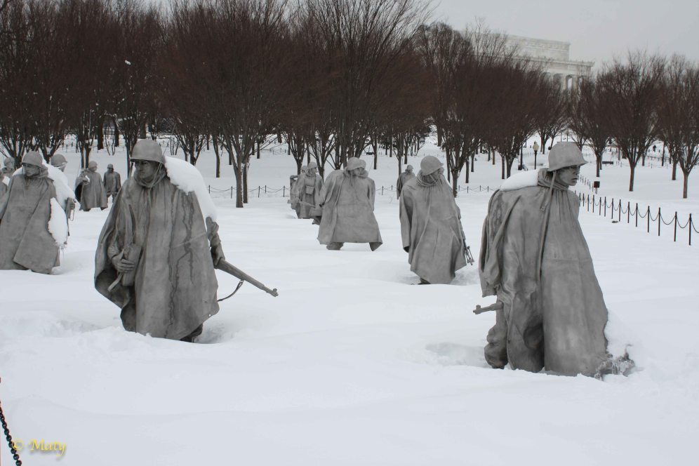 "Korean War Veterans Memorial - platoon of US Soldiers is moving in the ""V"" formation;"