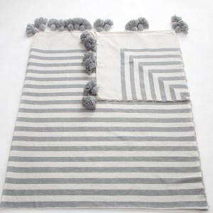 grey and white cotton blankets