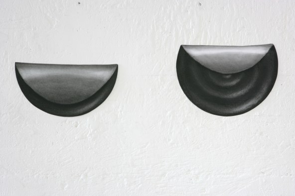 HEAVY EYELIDS, 2008, black stone on paper, 50 cm diameter each.
