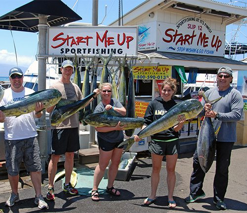 Maui Sport Fishing - Group of fisherman with Mahi-mahi caught aboard Start Me Up Sport Fishing