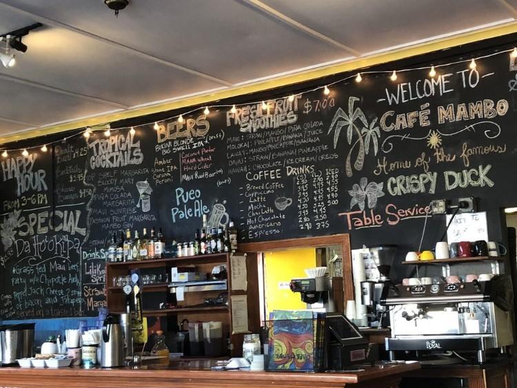 menu board at cafe mambo happy hour