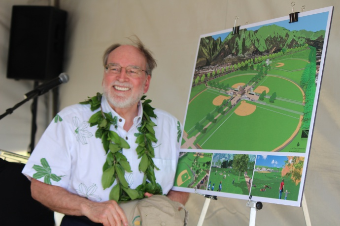 Governor Neil Abercrombie posing next to a project rendering for the future  Central Maui Regional Sports Complex.