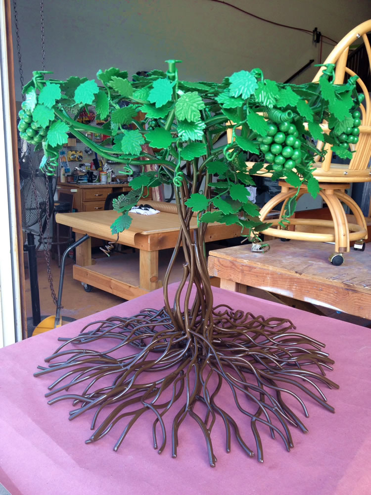 This was a sad looking junk yard find till our client saw it as a fabulous conversation piece for her Kaanapali home. We coated the trunk in Columbia Coatings Sepia Brown and the leaves in C.C.Emerald Green, a two part process & a really happy client!