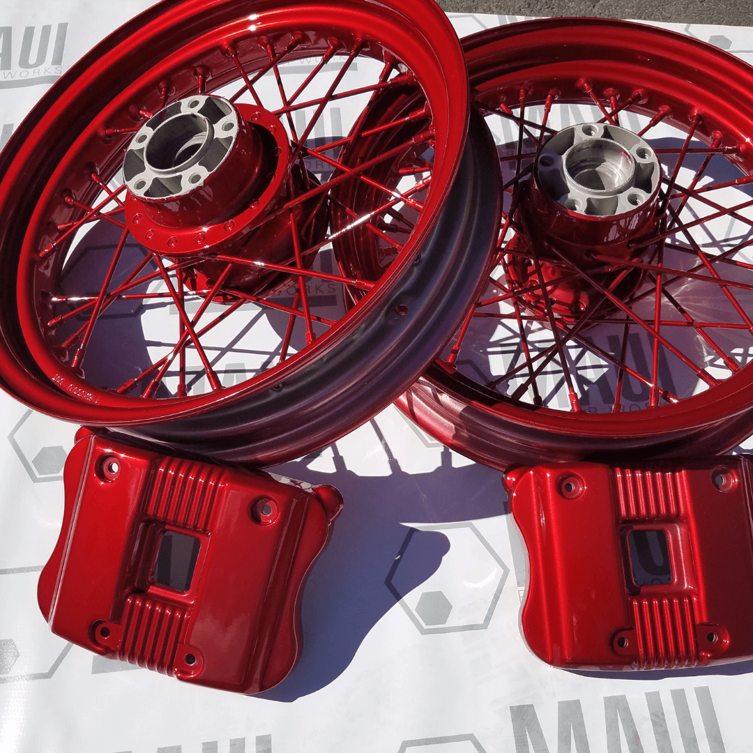 Spoked Harley Davidson Wheels and cam covers in Lollypop Red by Maui Powder Works.