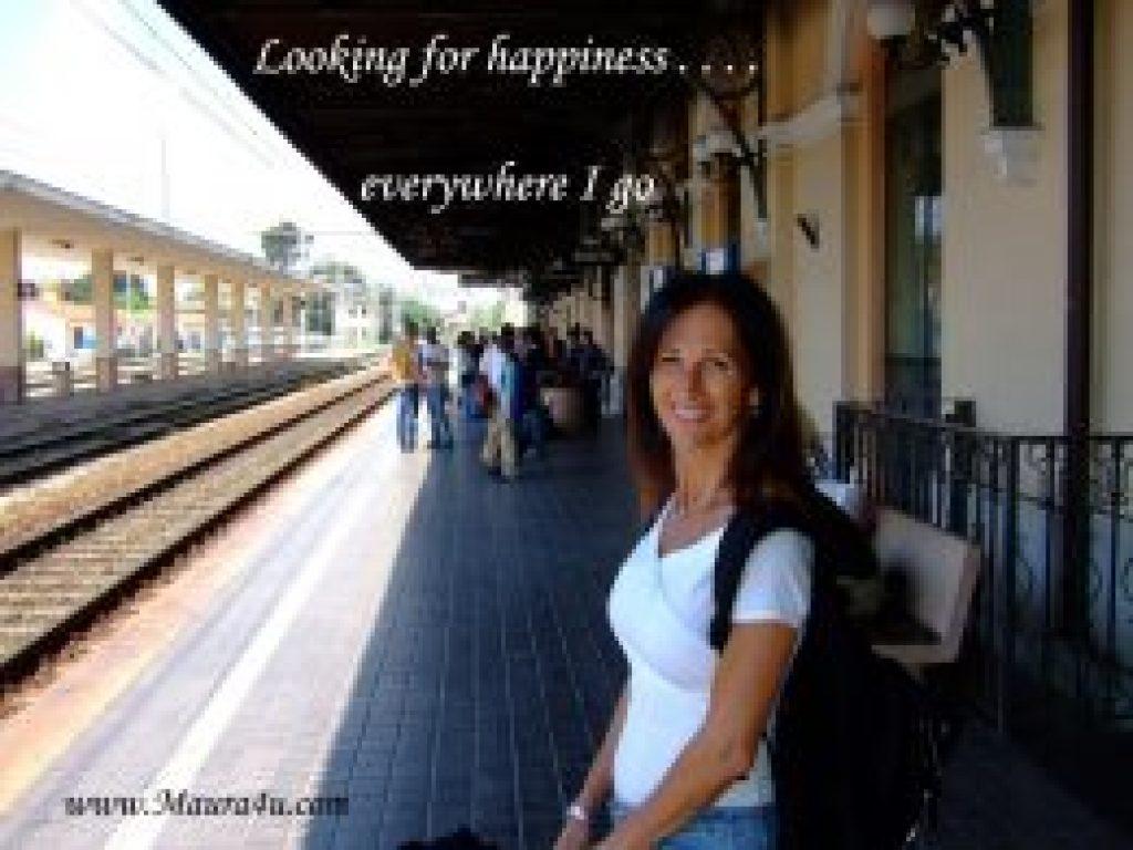 Maura Sweeney at railroad station in Italy - www.Maura4u.com