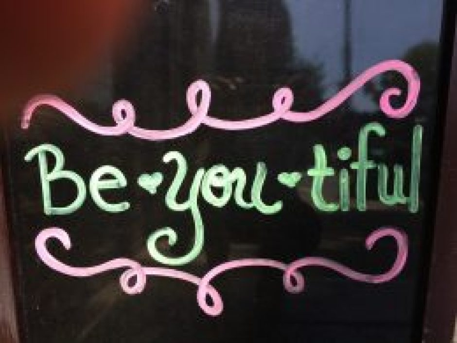 A window store ad in Brooklyn, NY says it all in a reminder to Be your beautiful self