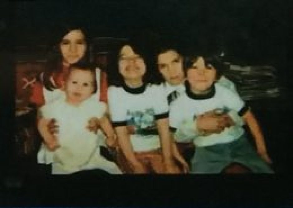 """A photo of Regina and her siblings, one of several """"treasures"""" she managed to carry with her throughout childhood."""