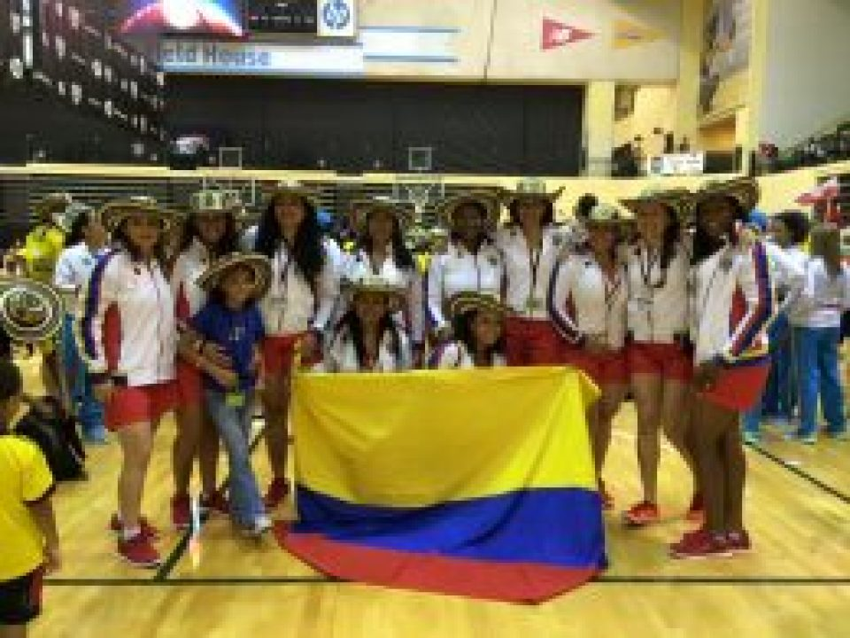 A Columbian Women's Team in Cultural Attire Readies for Opening Night Festivities