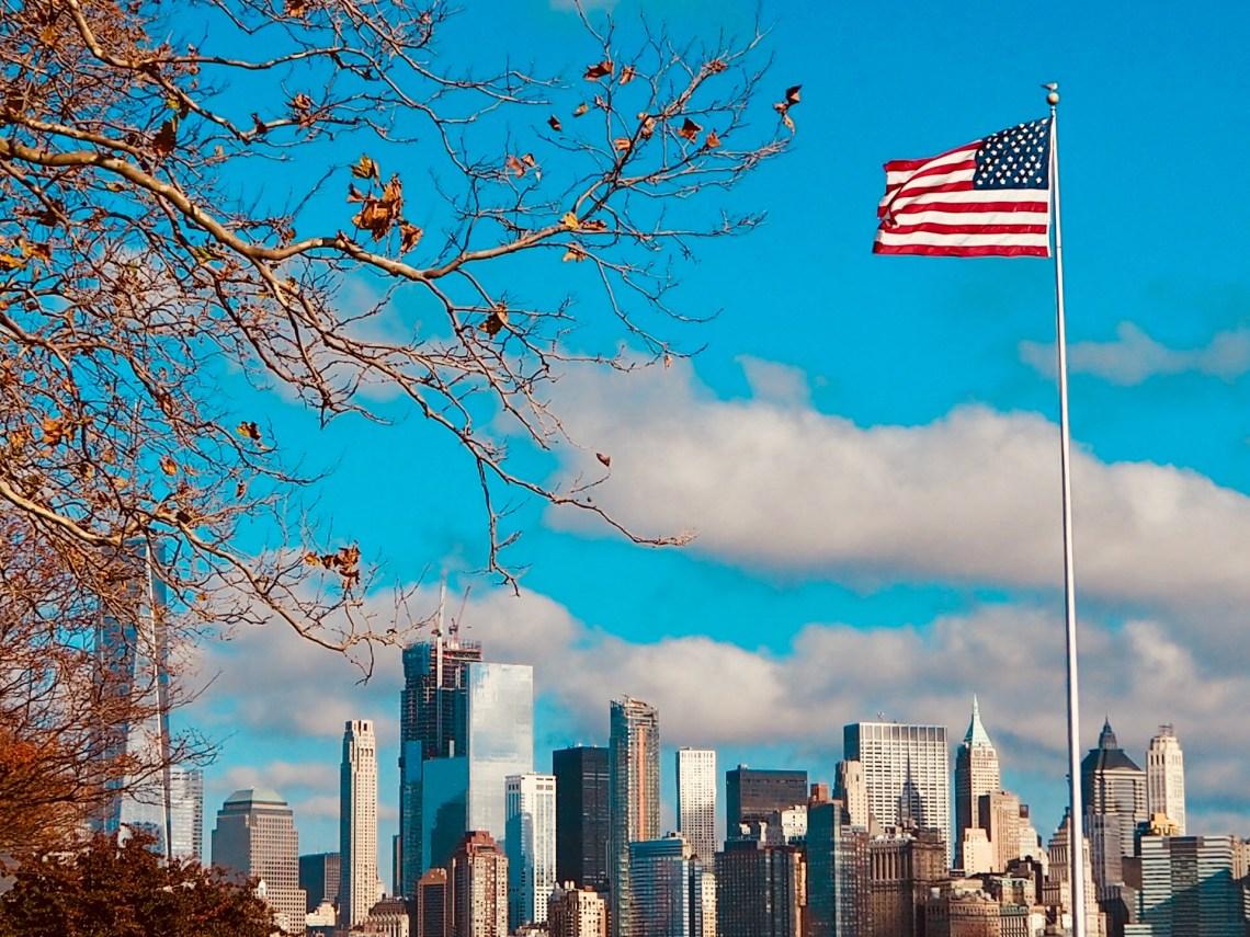 New York City skyline with US flag flying high