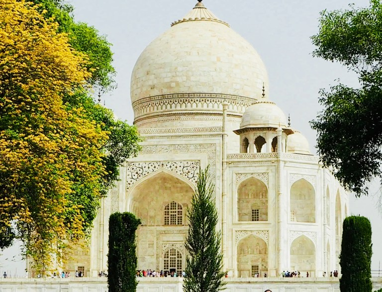 White dome-shaped ornate arches of the Taj Mahal in India
