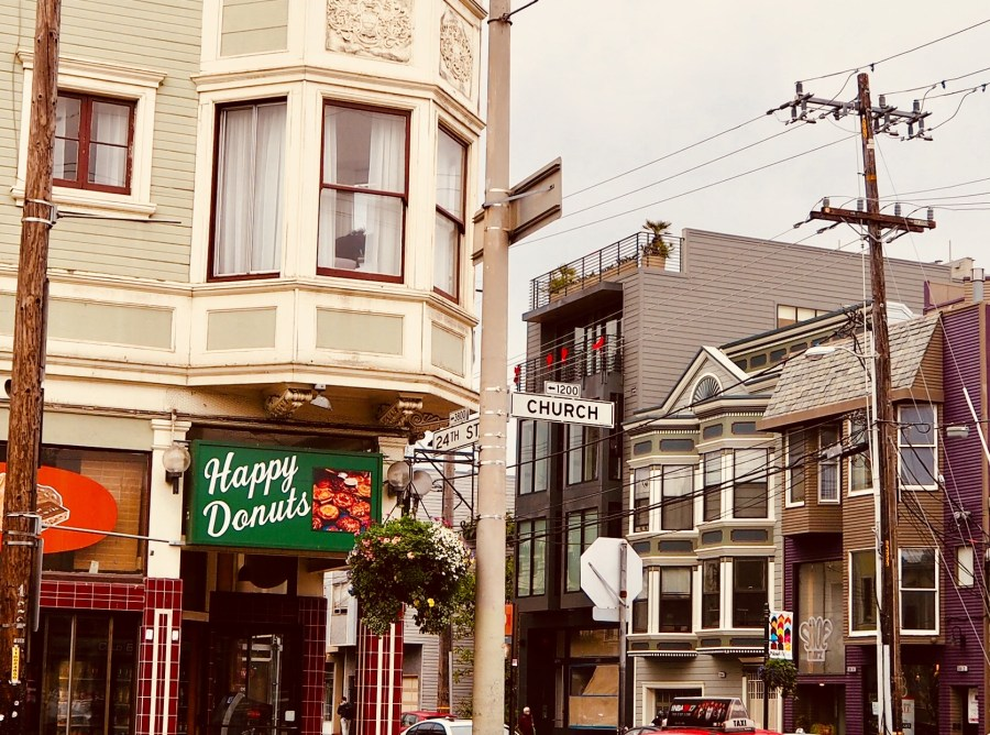Street scene in Noe Valley with bay window above a donut shop