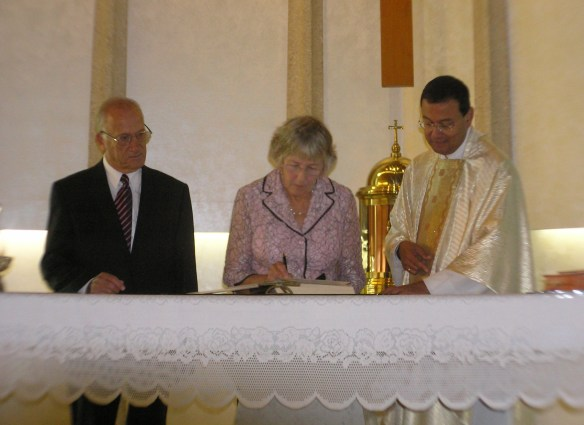 Signing the register with Fr Simons