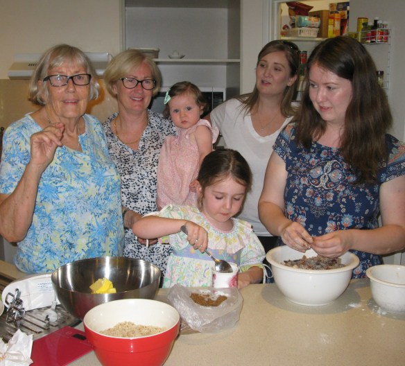 Generations four, five, six and seven sharing a kitchen