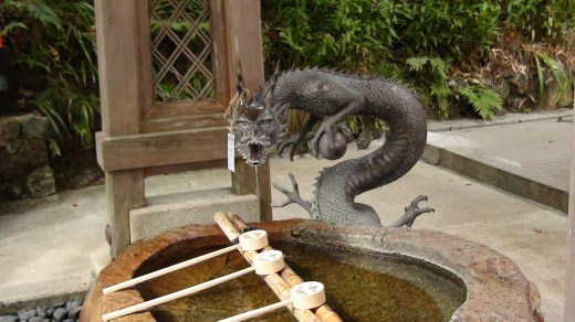 At a sacred temple in Japan, Kyoto, halfway up the mountain, is this sacred well, where the dragon fount is.