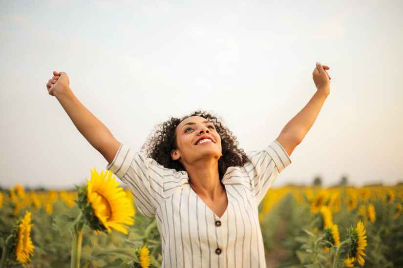 Woman rejoicing and giving thanks for the half way of the journey