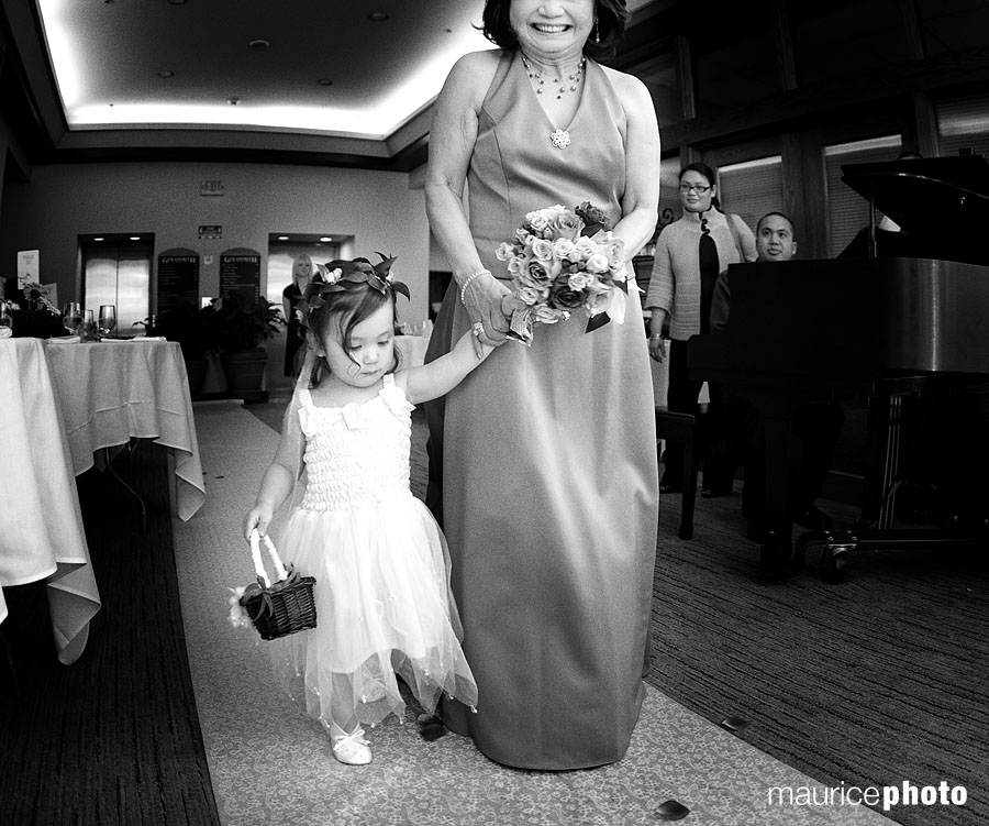 Mother of the Bride and Flower Girl walking down the aisle