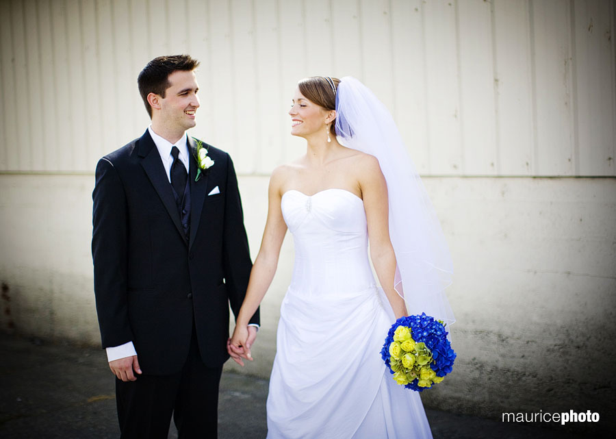 Portraits of a bride and groom in front of a barn at Lord Hill Farms in Snohomish