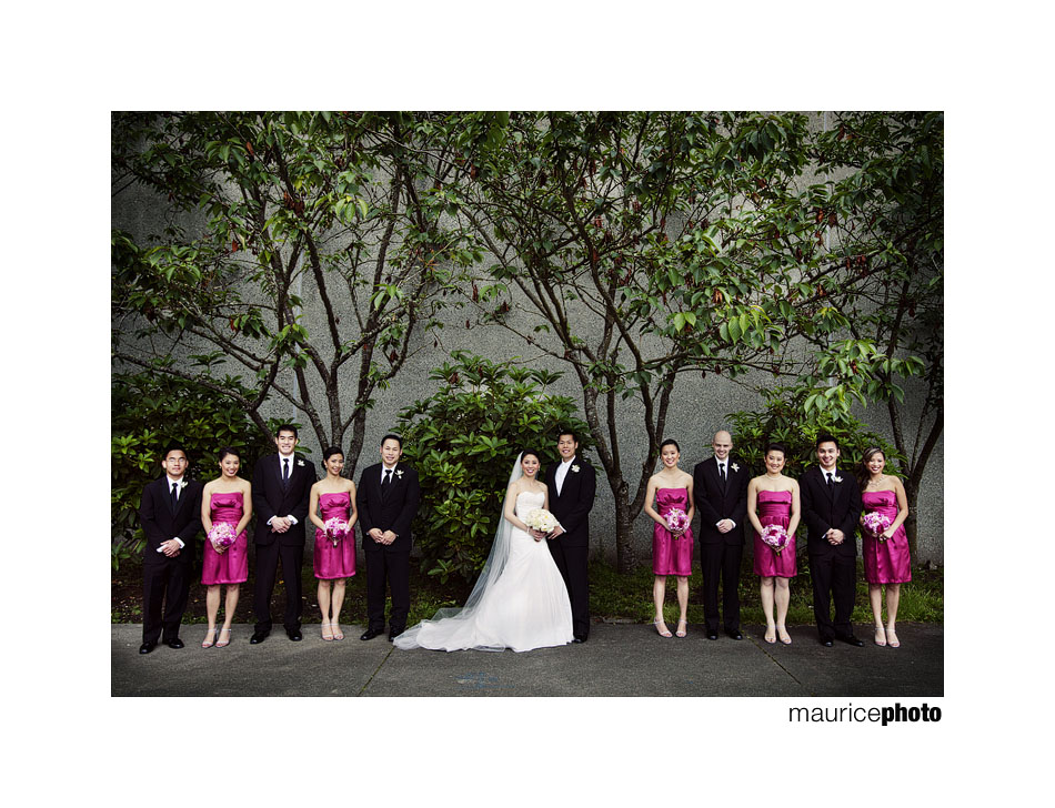 Photo of a bridal party posing outside the Parish of Saint Louise in Bellevue