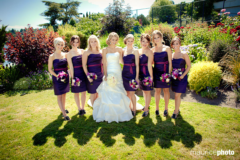 Bridesmaids pose with the bride for formal pictures