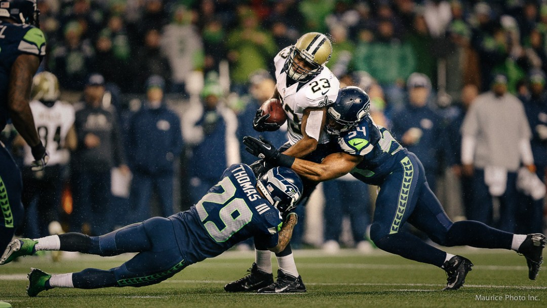 Gang tackle by the Seahawks Defense