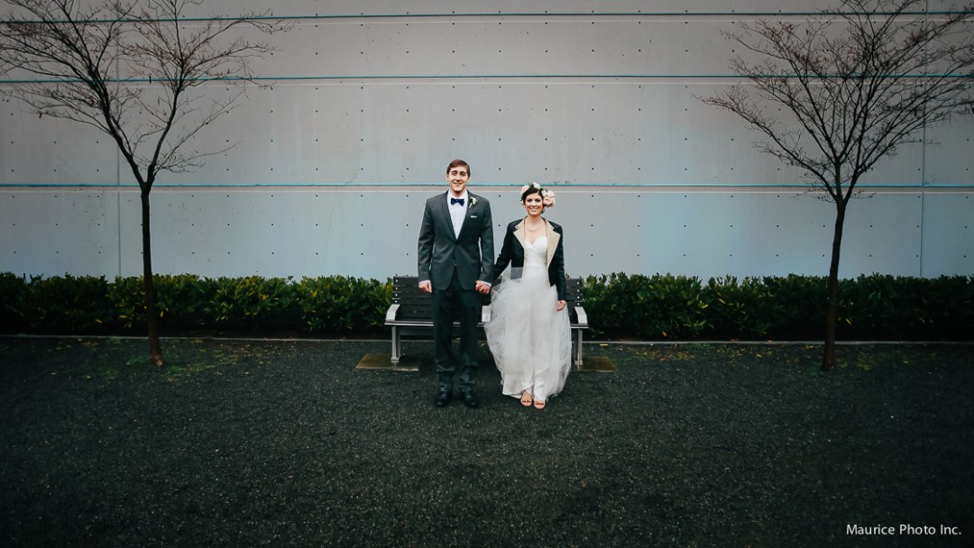 Bride and Groom pose for photos in the rain