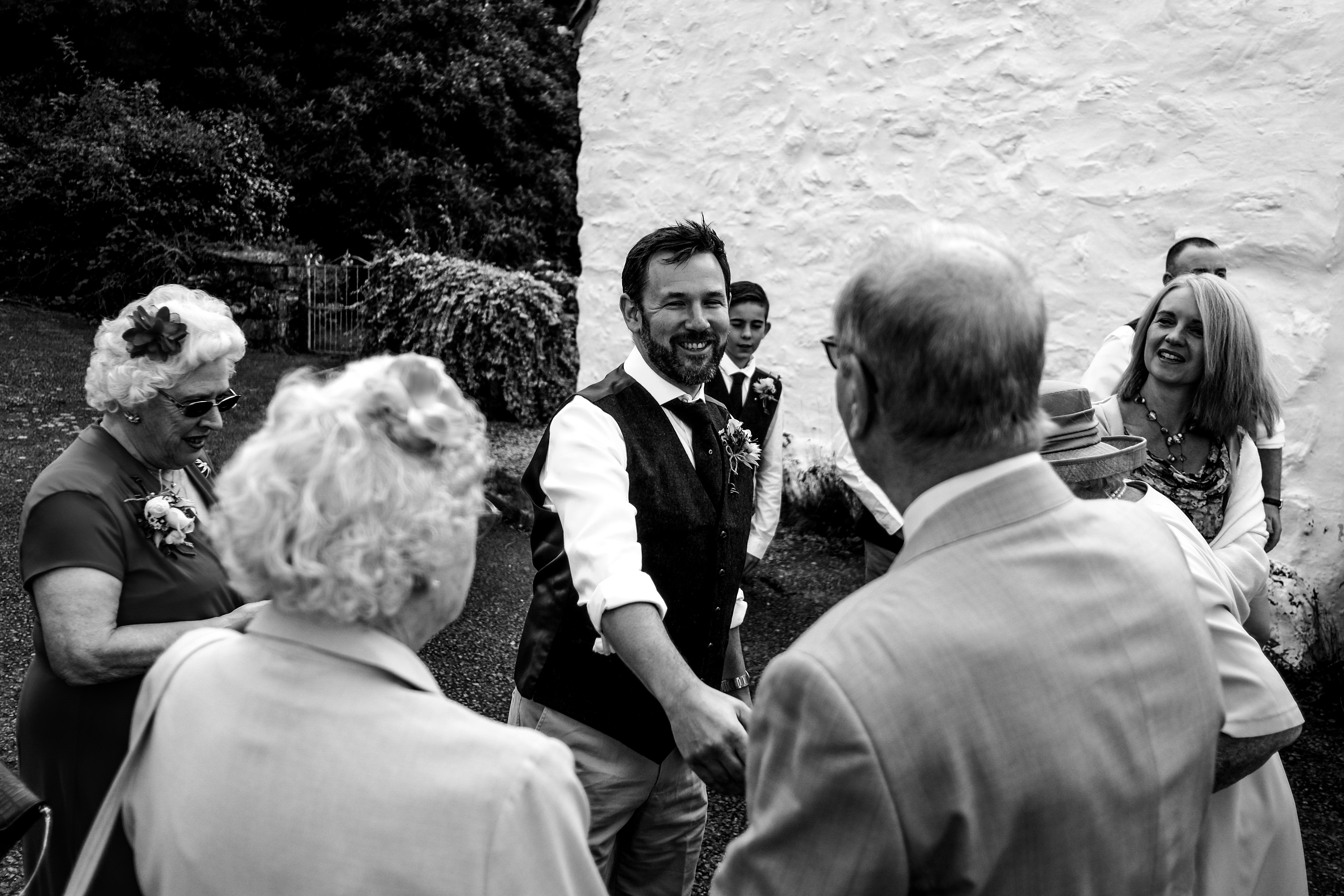 Groom greeting his family lot's of smiles and laughter.