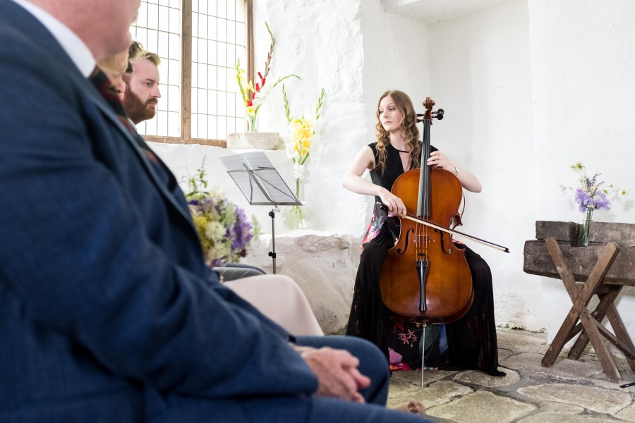 Cello player, playing at the wedding ceremony.