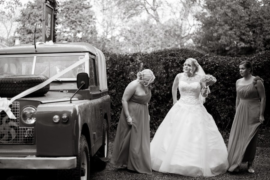 Bride with her bridesmaids ready to board the wedding car