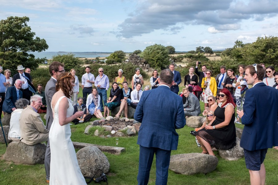 North Wales Wedding Photographer. Picture of wedding speeches outside at Ty Coch Red Welly. Image by Maurice Roberts Photography.