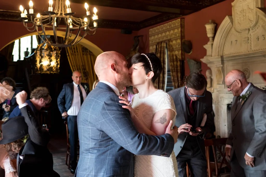 Bride and groom kiss at Trevor Hall