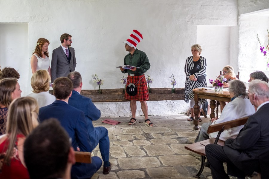 The cat in the hat reading at a Penarth Fawr wedding.
