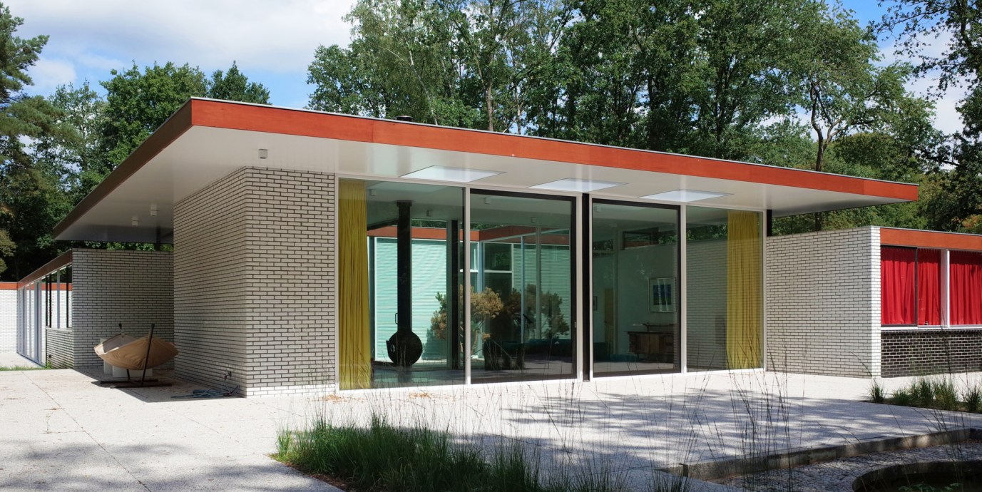 Original Rietveld House in Netherlands with garden and trees. Redesign and refurbished architect Maurice van Bakel