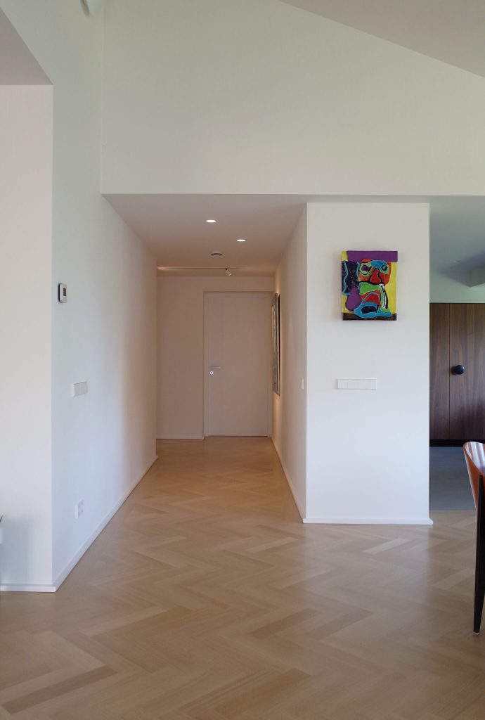 herringbone wooden floor in penthouse design by architect Maurice van Bakel