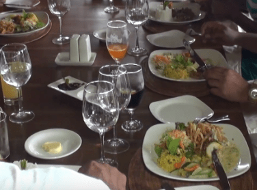 Visitors taking lunch at Bois cheri restaurant. Showing some dishes of the reataurantBois Cheri
