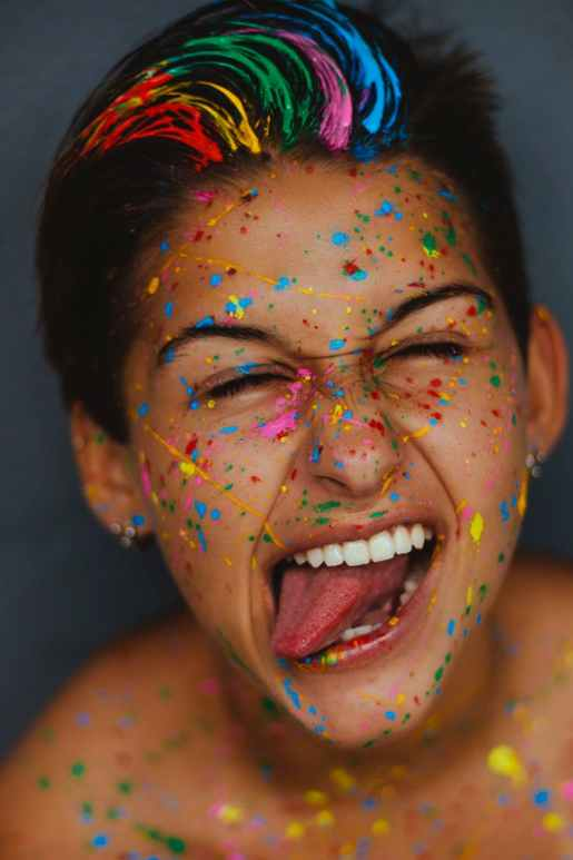 woman s face with color splatters