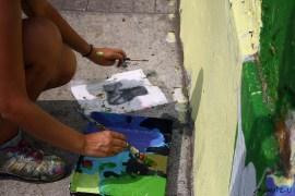 Lili Cuca (Colombia) pintando en Jr. Lampa, Lima.
