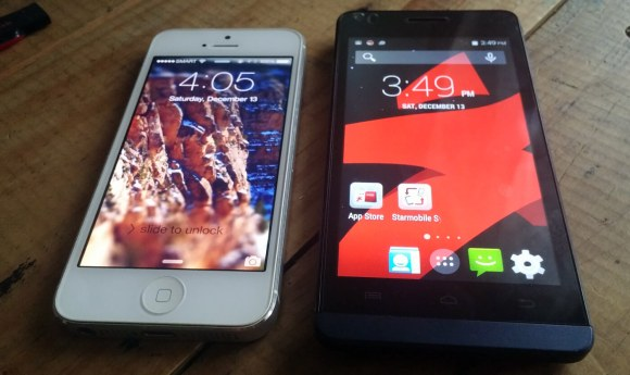The UP Mini and an iPhone 5.
