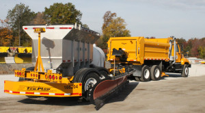 INDOT's new Tow-Plow truck is capable of clearing snow from two lanes of a divided highway at once.