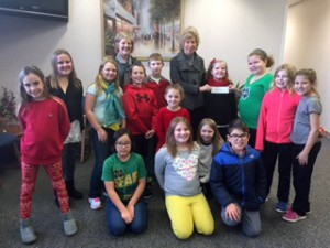 Menominee Elementary School Fourth graders present the profits made from working in the school store to United Way. Front, Left to Right: Lily Macy, Skye Shook, Izabella Baldwin, Myla Hamater, Diego Gifford, Mackenzie Dohner, Reina Sanderson, Cray Barden, Serenity Harding, Max Lewandowski, Annie Plothow, Clara Smith, Madison Hauptmann, and Sophie Wray, Linda Yoder and Susan Wagner.