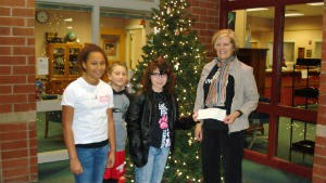 Riverside Intermediate School Student Council United Way Committee members present check from fundraising efforts to United Way. Pictured are Nena Roberts, Roman Snedeker, Rachel Ray, and Linda Yoder
